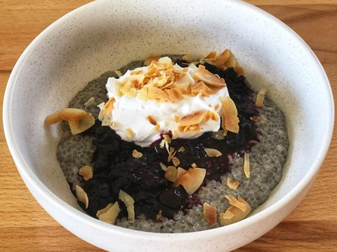 Chia pudding with black currant compote, whipped coconut cream & toasted coconut chips.jpg