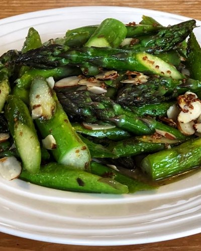 Pan fried asparagus with a warm Kombucha dressing and toasted almonds